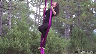Flying yoga striptease by sex appeal babe with flexible body Kim Nadara